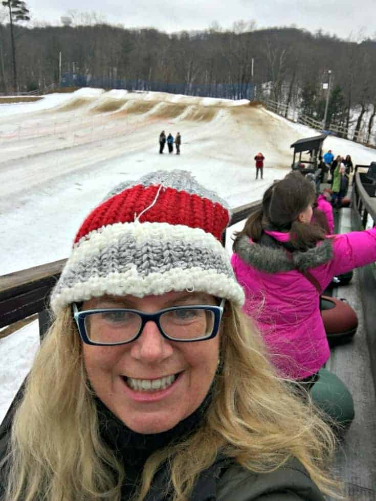 Tubing at Horseshoe resort in a columbia cold climate coat and canadian hat