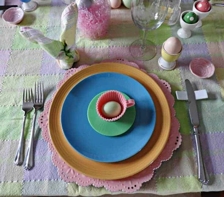 easter place setting with pink charger and bunny napkin