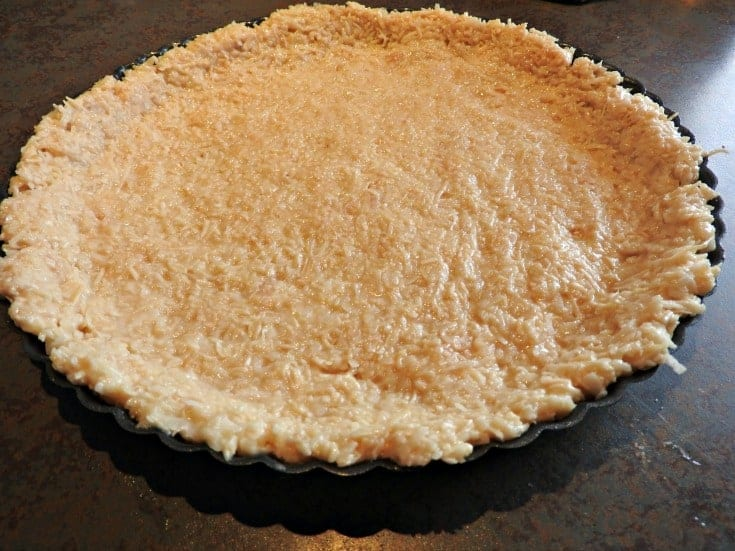 coconut crust in a flan pan