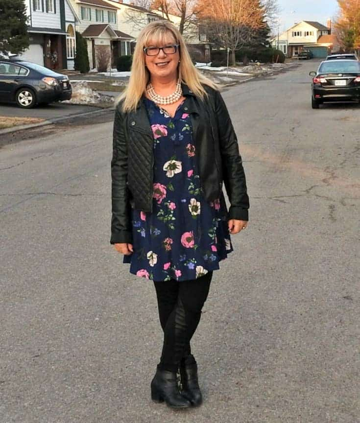 on the street in Old Navy Floral Frock with a leather moto and buckle boots