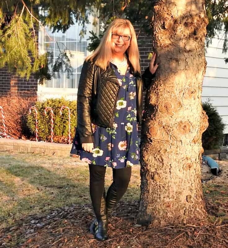 tree hugging in Old Navy Floral Frock with a leather moto and buckle boots