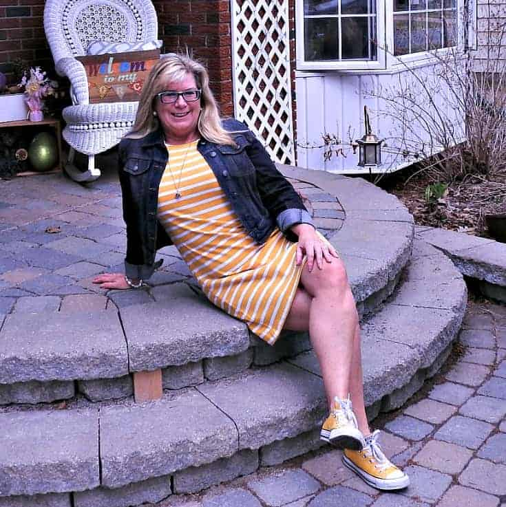 relaxing in a Old Navy Yellow Tee Dress with Stripes, Converse and a denim jacket and a 7 charming sister necklace