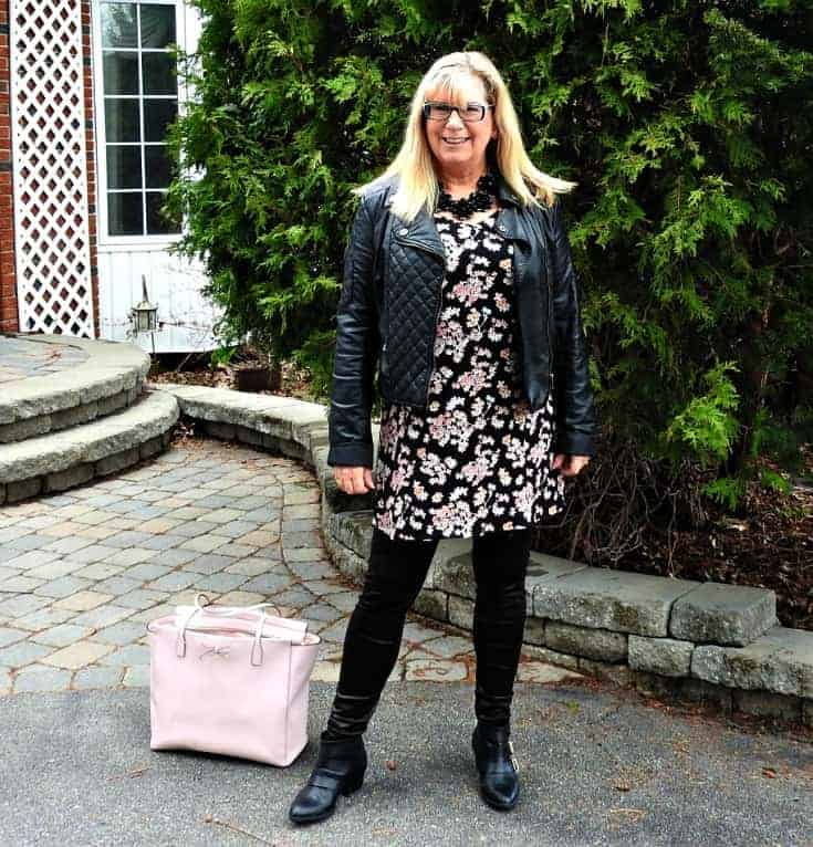 Lily morgan floral tunic, svelte shapewear and a black moto jacket with a Kate spade bag