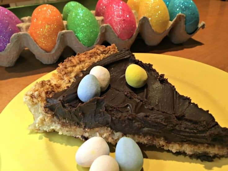 slice of chocolate macaroon pie for dessert-this easy macaroon recipe is baked into a pie crust and then filled with a rich chocolate ganache filling