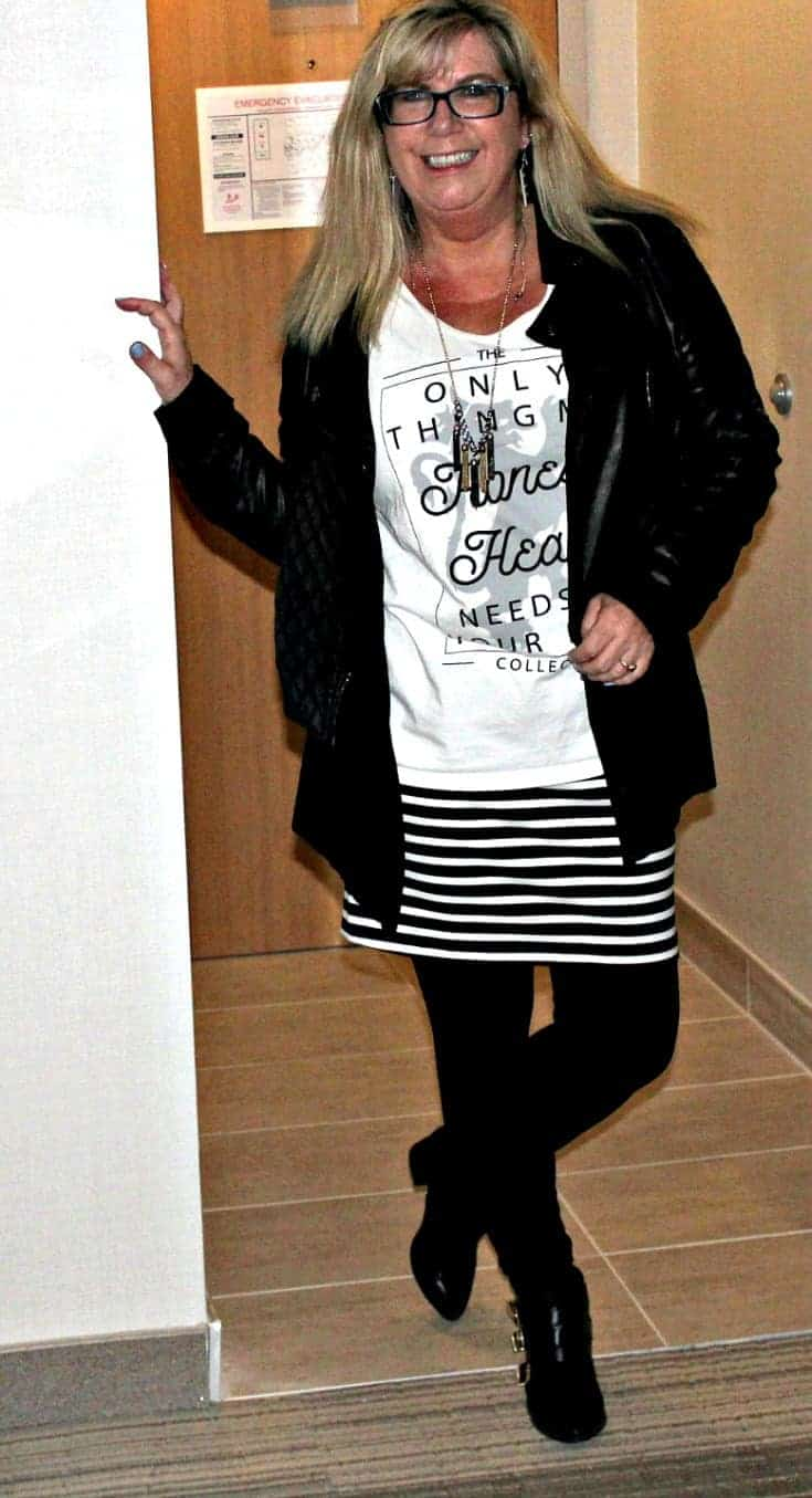 striped skirt, keyboard earrings and a black moto jacket with an Honest Heart Collective Tank