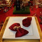 rose napkins on a plate