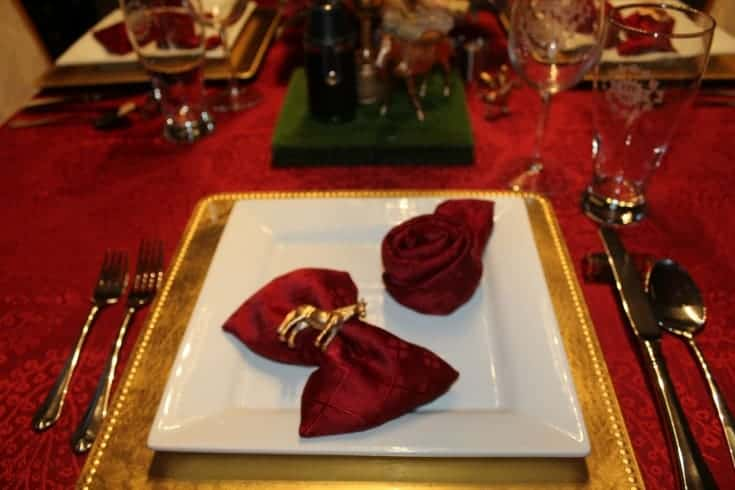 rose napkins on a plate