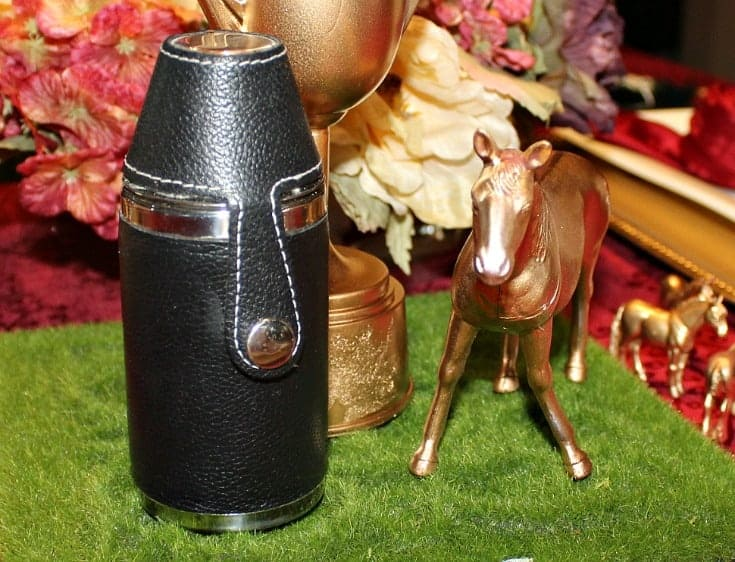 a flask and a golden horse