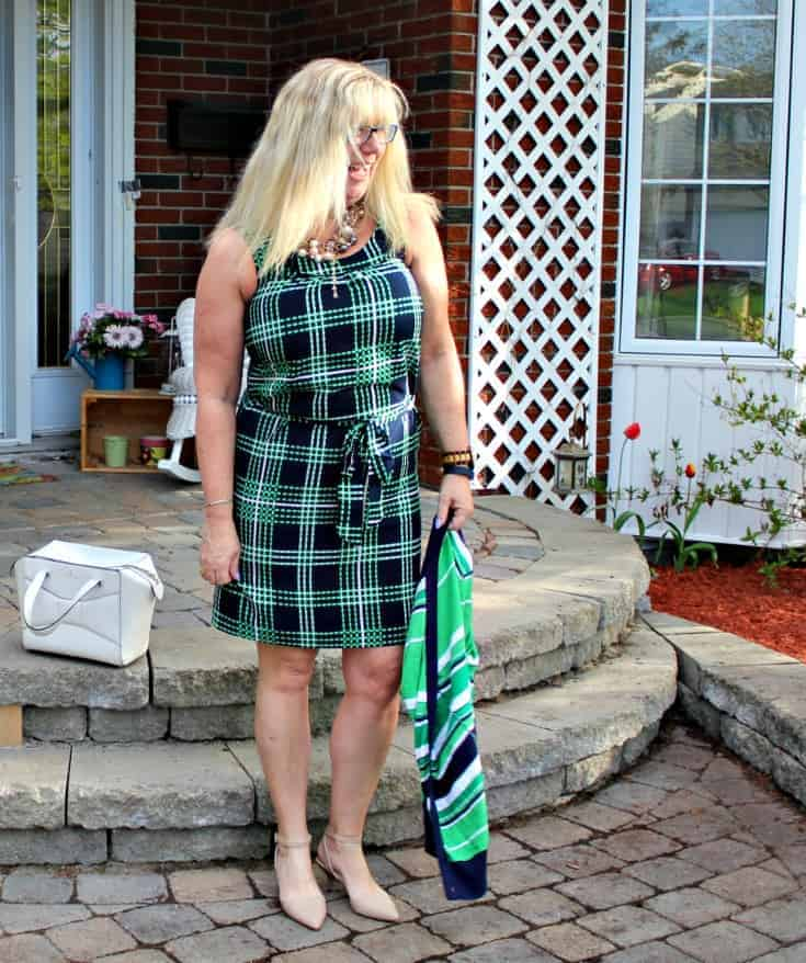 laughing in Banana republic stripes and plaids with pearls, nude heels and a kate spade