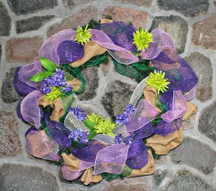 pretty spring like wreath on the fireplace