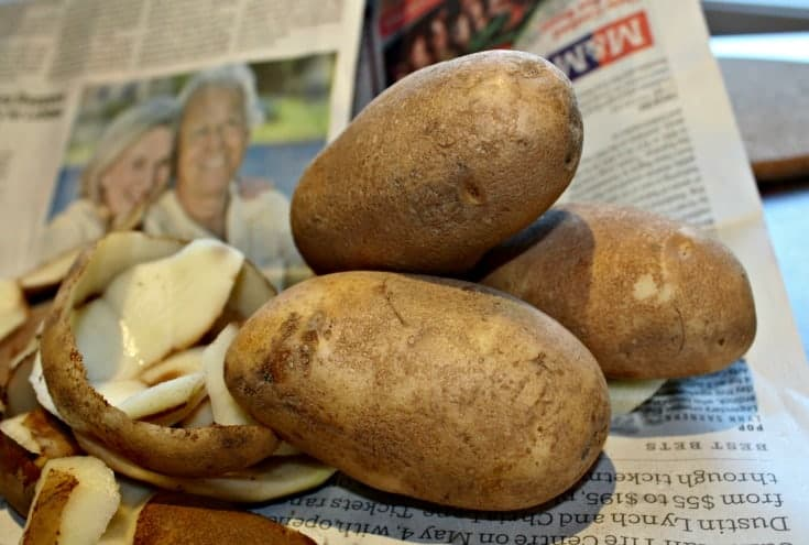 peeling potatoes for homemade potato salad