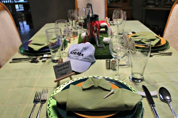 Fathers Day Golf Theme Table with green shirt napkins and golf centrepiece