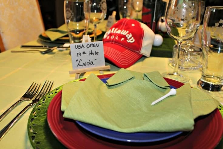 Fathers Day Golf Theme Table with green shirt napkins and fun golf place cards