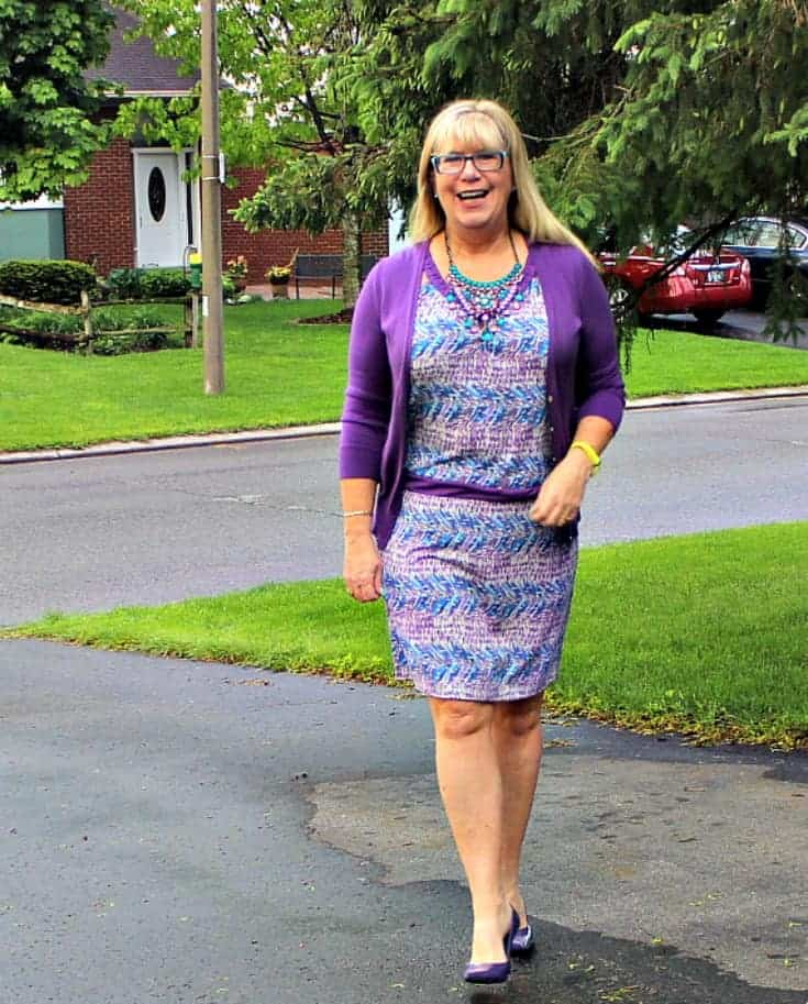 strolling in a Purple and teal dress with matching cardi and a statement necklace from 7 Charming Sisters with a pair purple pumps