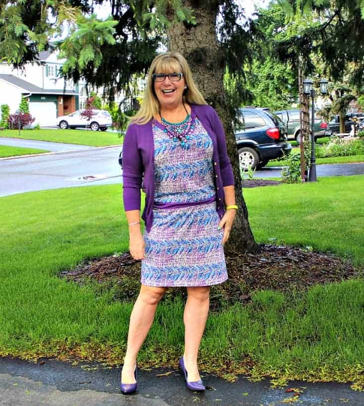 Banana Republic Purple and teal dress with matching cardi and a statement necklace from 7 Charming Sisters with a pair purple pumps