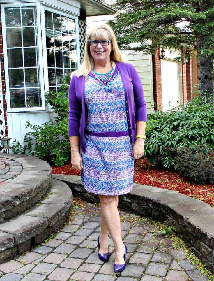 Purple and teal dress with matching cardi and a statement necklace from 7 Charming Sisters with a pair purple pumps 4