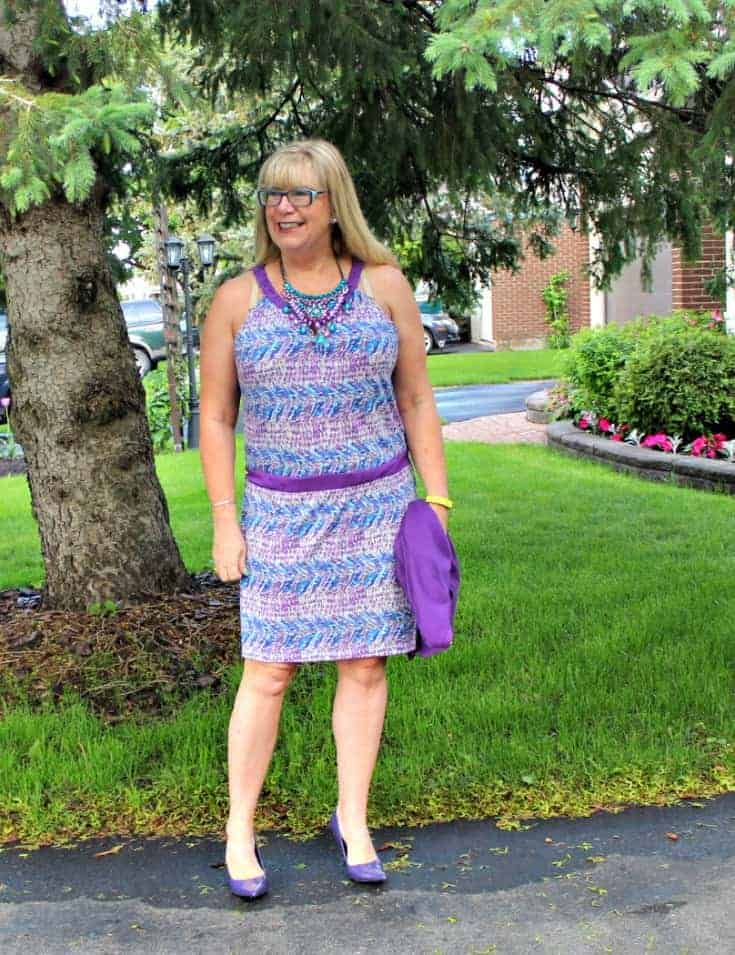 Purple and teal dress with matching cardi and a statement necklace from 7 Charming Sisters with a pair purple pumps 2