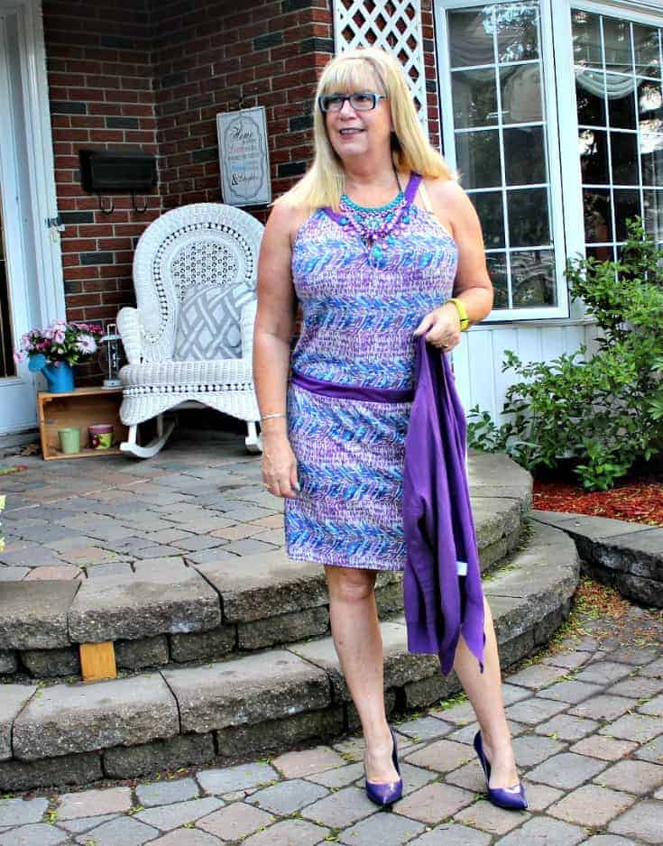 Purple and teal dress with matching cardi and a statement necklace from 7 Charming Sisters with a pair purple pumps
