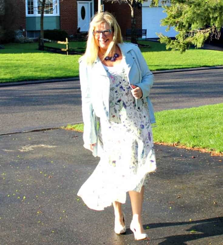 walking in h&M floral dress with striped shoe dazzle pumps and a moto jacket