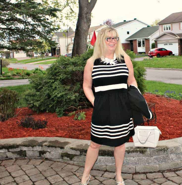 I am Fierce in a J Crew dress ,7 Charming Sisters white floral necklace and Shoe Dazzle slingbacks with a Kate Spade Beau bag