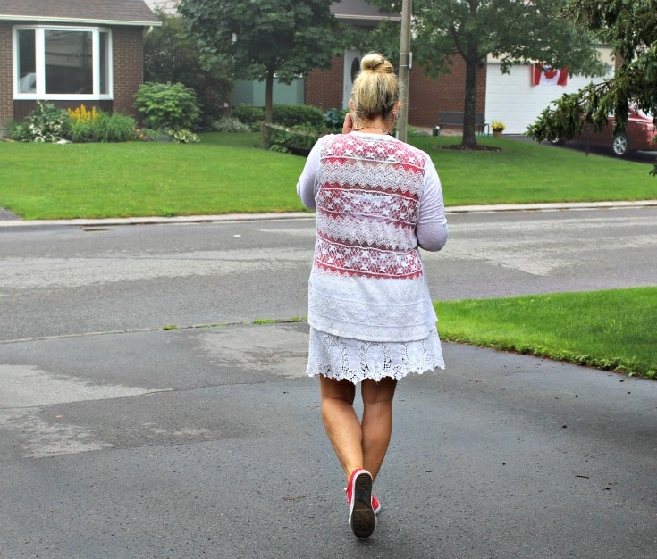 walking away in Joe Fresh white lace skirt with a red tee and lace cardigan, paired with converse and a 7 Charming Sisters necklace