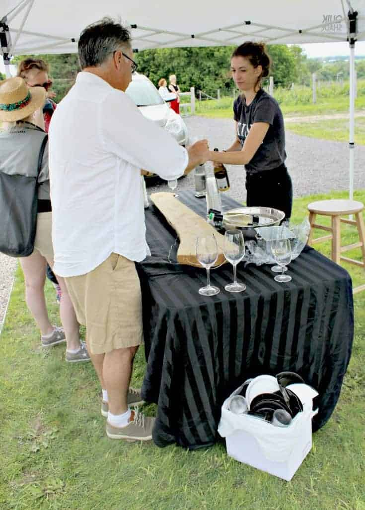 Kent sampling the wine at the Grand Opening of Kin Vineyards