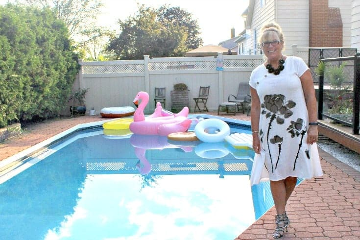 poolside in Fashion Mia White Linen Shift with a black floral necklace