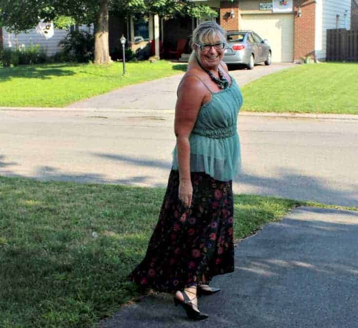 walking in a Eshakti skirt with a sage green cami and tie up kitten heels from Shoe Dazzle