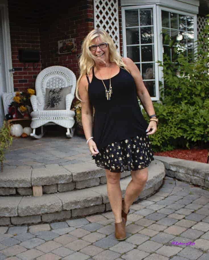 A fun flirty skirt with a cami paired nicely with the boots.