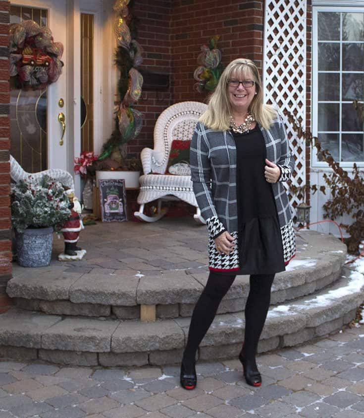 Plaid and herringbone patterned sweater from Laura's and a leather skirt