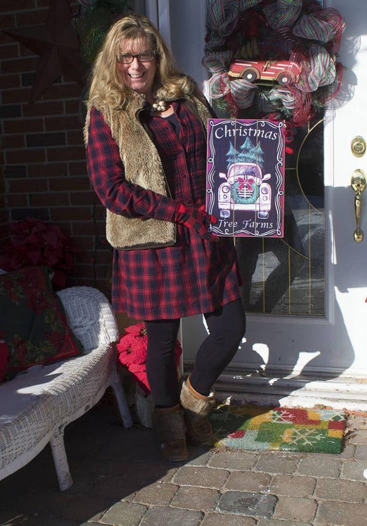 Fur vest and a J Crew plaid dress with fur trimmed boots