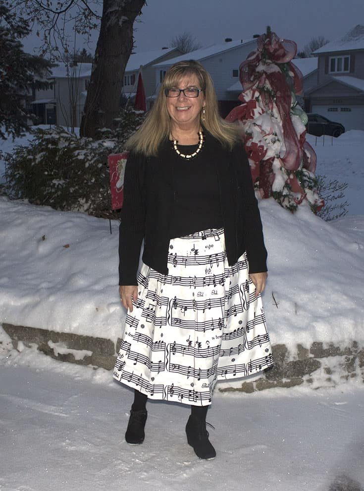 smiling in my Music note skirt with a henley and a black wool moto jacket with black suede skecher wedges