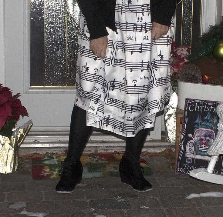 black skecher wedges and a fun skirt