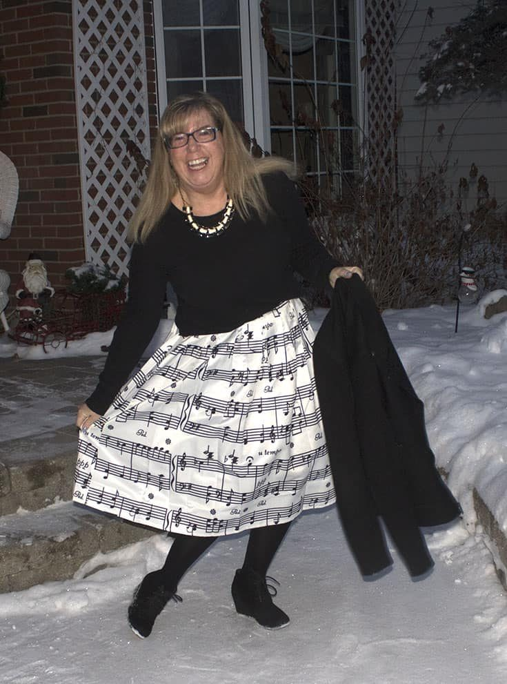 Music note skirt with a henley and a black wool moto jacket with black suede skecher wedges make the perfect outfit
