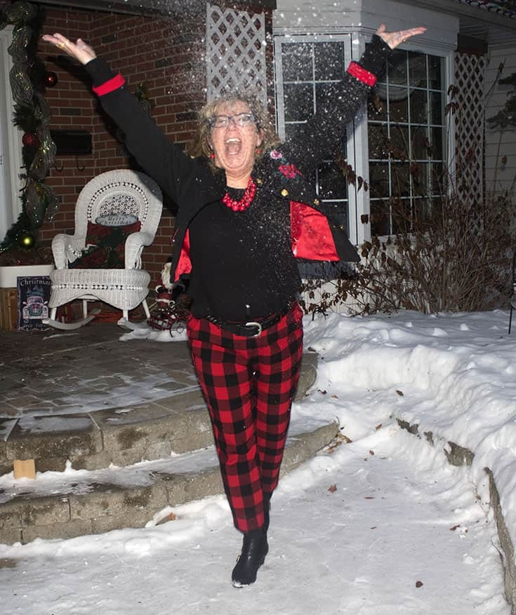 playing in the snow in Red Plaid Harper Pants from Old Navy paired with a black tee and a fun embroidered blazer from Target.