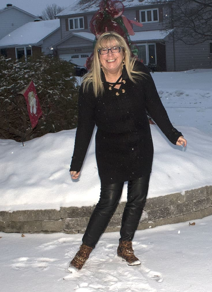 Lace up black tunic sweater from Target paired with leather leggings and fun leather booties
