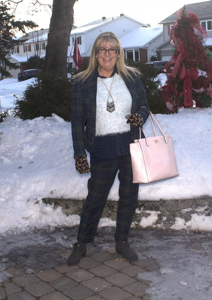 Sheldon Suit with a warm blue sweater and a pink Kate Spade Bag