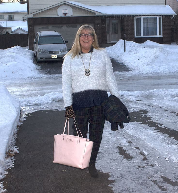 Sheldon Suit with a fuzzy blue sweater and a pink Kate Spade Bag