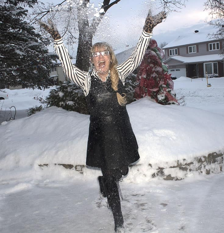 playing in the snow in a leather dress