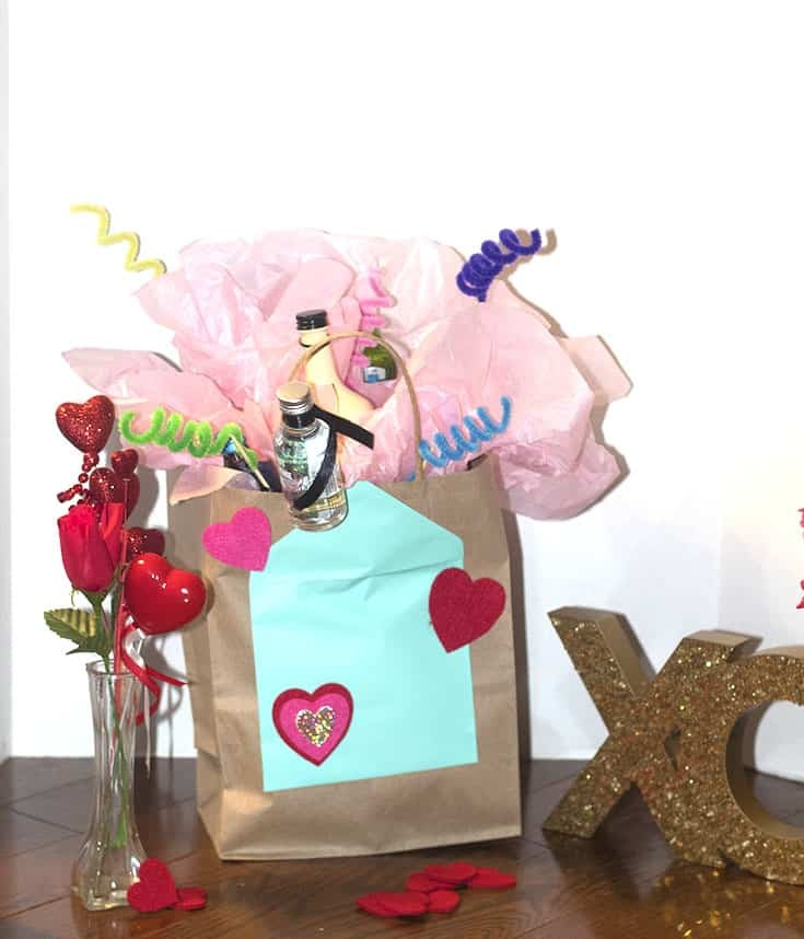galentines alcohol bouguet in a paper bag