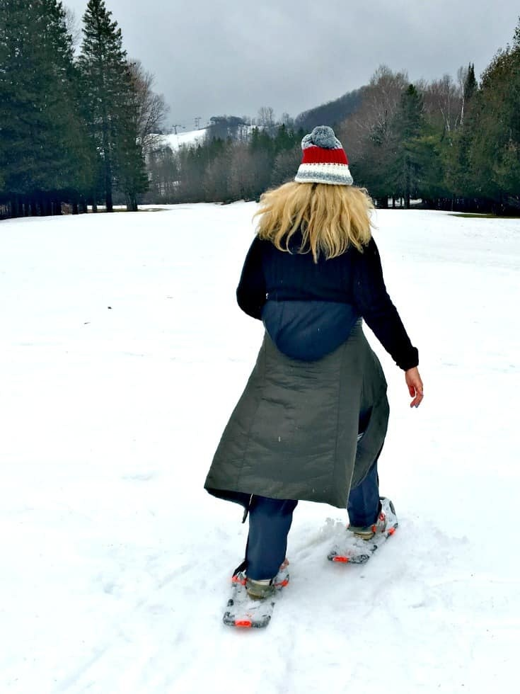 snow shoeing in the mountains