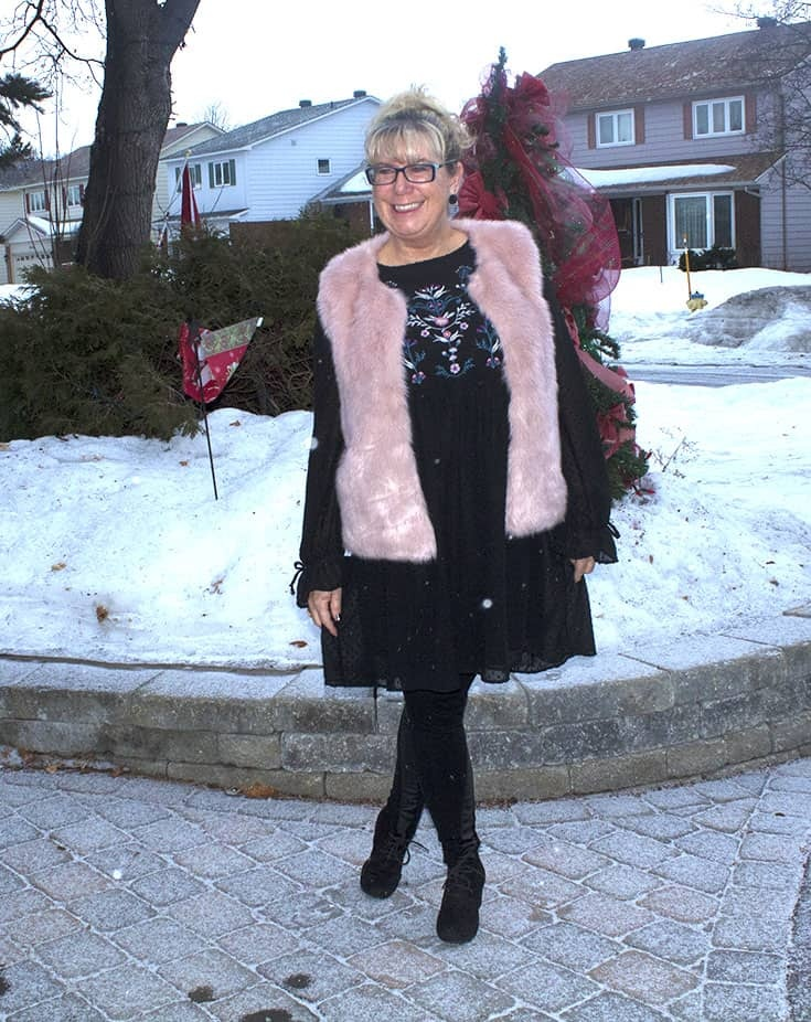 a fun pink fur vest and an embroidered smock dress from Target. With Svelte leather leggings and black skecher wedges
