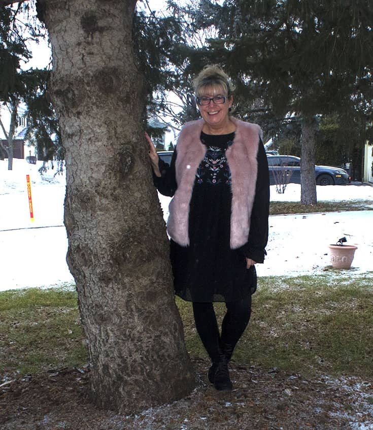 a fun pink fur vest and Floral smock dress from Target with skecher wedges