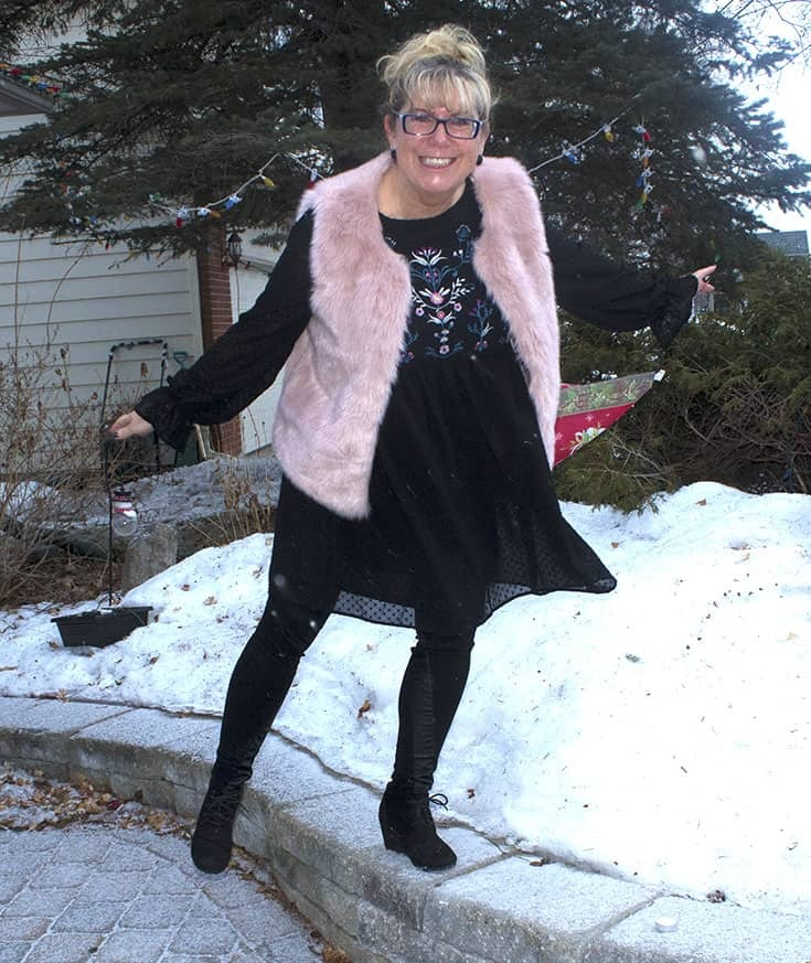 Floral smock dress from Target with a fun pink fur vest and skecher wedges