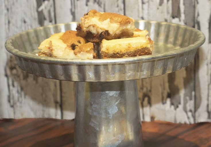 Chocolate chip cookie dough cheesecake squares in a galvanized cake plate
