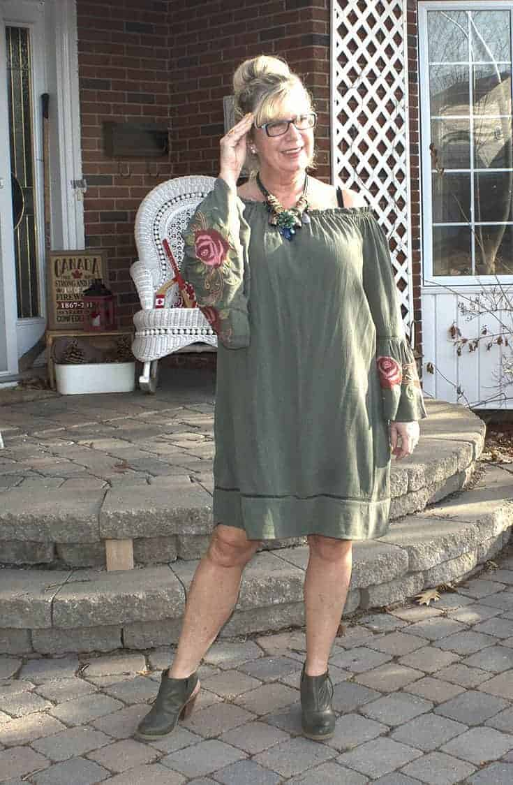 Sage green off the shoulder dress from Target with embroidered sleeves and Nine West boots 3