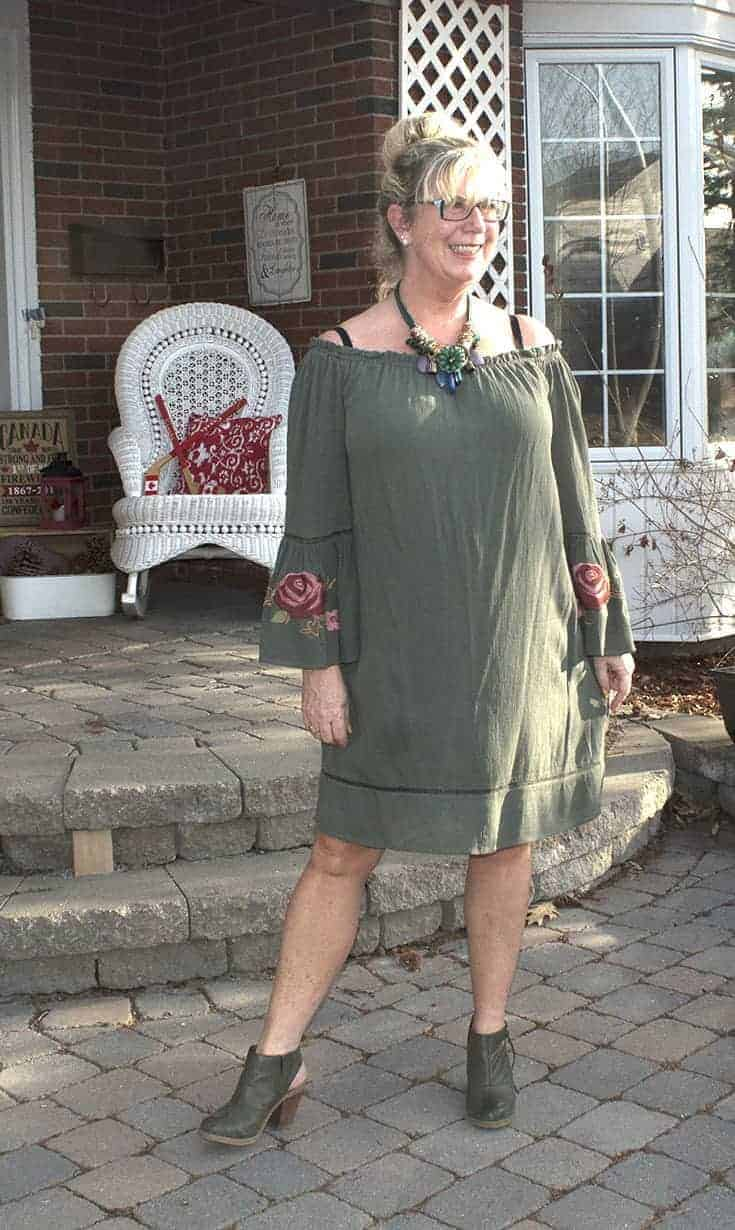 Sage green off the shoulder dress from Target with embroidered sleeves and Nine West boots
