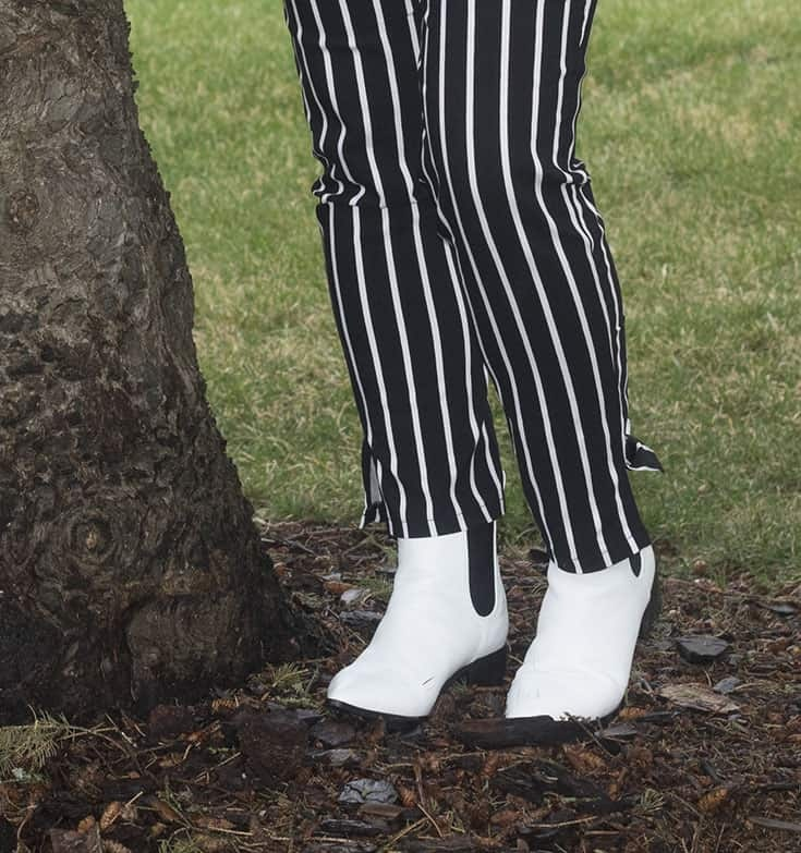 white boots and fun strip pants