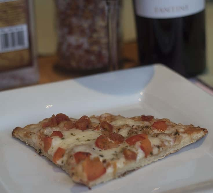 cauliflower pizza crust on a white plate