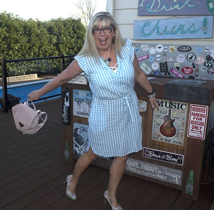 Blue gingham dress with pastel floral shoes and a Drew pink blush bag